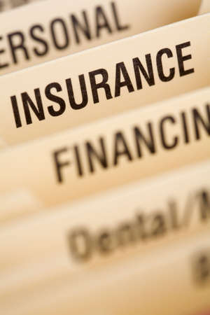 household insurance: Close up of folder for household bills with focus on insurance section