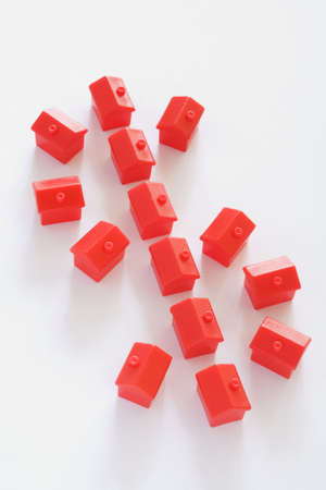 negative equity: Dollar sign made up of red houses on white background Stock Photo