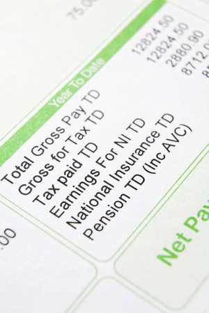 wage: Close up of payslip showing deductions Stock Photo