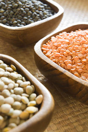 Selection of lentils in wooden bowls