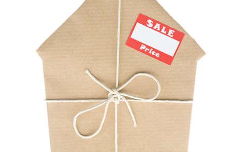 first time buyer: Studio Shot Of House Wrapped In Brown Paper With Sale Sticker