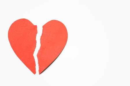 heartbreak issues: Red Paper Heart Torn In Half Against White Background