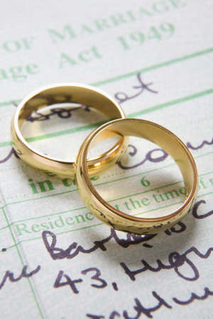 marriage certificate: Pair Of Gold Wedding Rings On Marriage Certificate