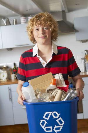 recycling bin: Boy Holding Recycling Bin