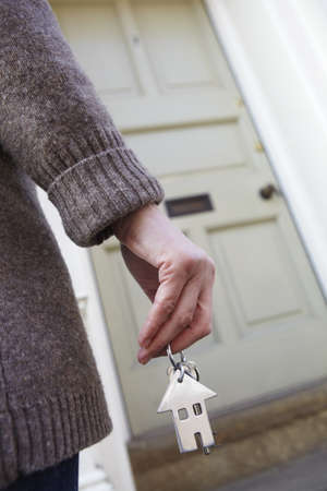 unrecognisable person: Woman Holding Keys To New Home