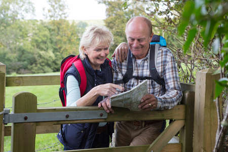 a hobby: Active Senior Couple On Walk In Countryside