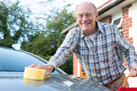 washing face: Portrait Of Senior Man Washing Car