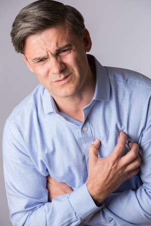 cardiac arrest: Studio Shot Of Mature Man Suffering Heart Attack