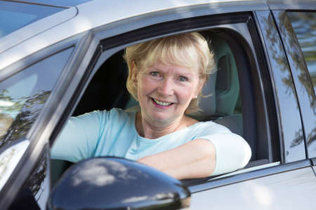 old people: Portrait Of Smiling Senior Woman Driving Car
