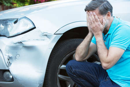 car wreck: Unhappy Driver Inspecting Damage After Car Accident