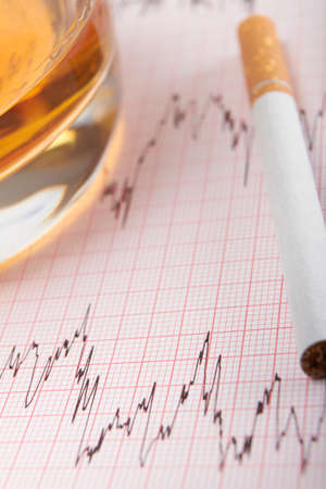 printout: Glass Of Whiskey And Cigarette On ECG Printout