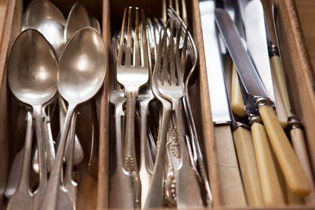 silver cutlery: Silver Cutlery Arranged In Drawer Stock Photo