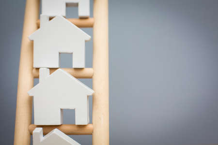 Model Houses On Wooden Property Ladder Foto de archivo