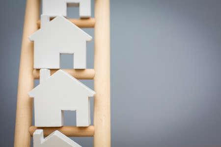 Model Houses On Wooden Property Ladder Standard-Bild