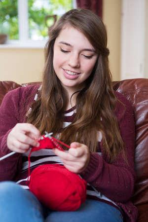 year old: Teenage Girl Knitting At Home Stock Photo
