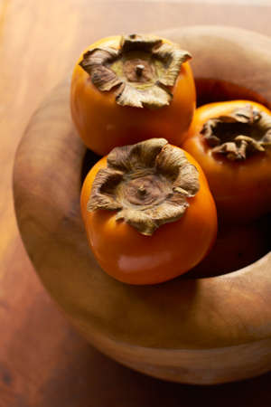 persimmon tree: Persimmion In Wooden Bowl