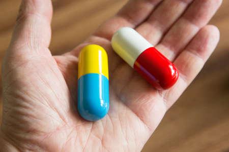 depressant: Close Up Of Hand Holding Oversized Capsules