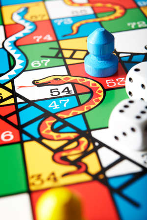 Close Up Of Snakes And Ladders Board Stock Photo