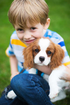 Close Up Of Boy With Pet King Charles Spaniel