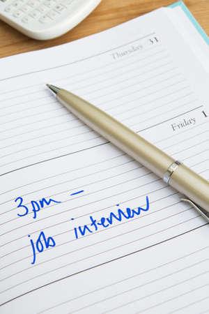 entrevista de trabajo: El diario cita para la entrevista de trabajo Foto de archivo