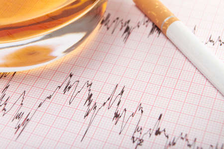 readout: Cigarette And Whiskey On ECG Readout Stock Photo