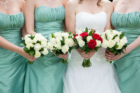 bride: Close Up Of Bride And Bridesmaids Holding Flowers Stock Photo