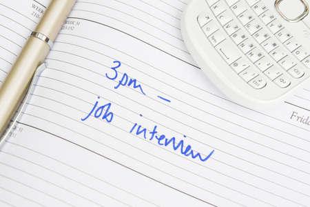 interview job: El diario cita para la entrevista de trabajo Foto de archivo