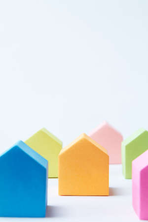 neighbourhood: Multi Colored House Shaped Blocks On White Background