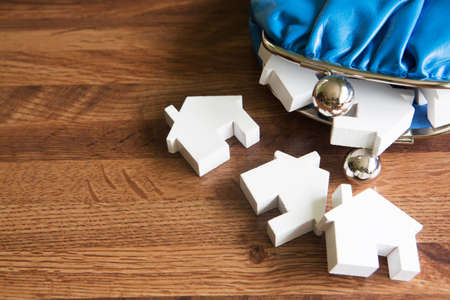 change purse: Model Houses With Change Purse To Illustrate House Purchase Stock Photo