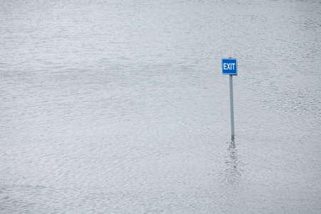 car park: Exit sign in flooded UK car park