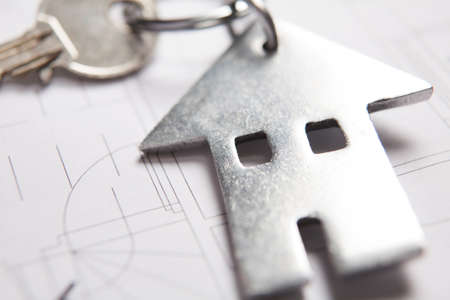 keyring: Keys To Home On Architects Plans With House Shaped Keyring