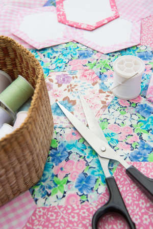 craft material: Close Up Of Quilting Fabrics And Accessories