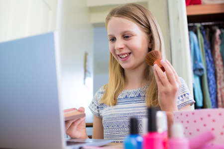 Young Girl Watching On Line Make Up Tutorial