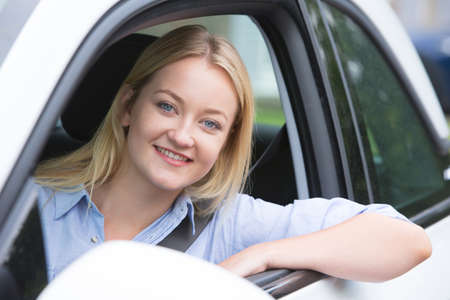 twenties: Portrait Of Young Woman Driving Car