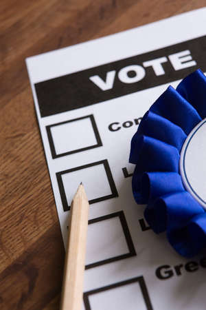 campaigning: Blue Political Rossette On Ballot Paper For Election Stock Photo