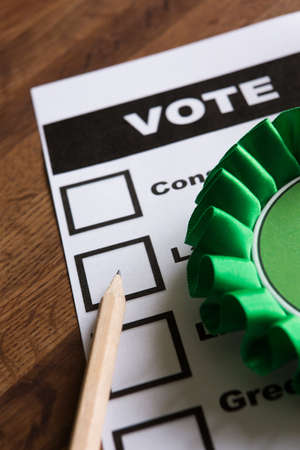 pencil and paper: Green Political Rossette On Ballot Paper For Election