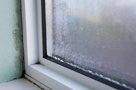 House Window With Damp And Condensation Standard-Bild