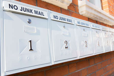 mail slot: Line Of Mailboxes With No Junk Mail Notice