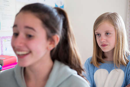 shaming: Young Girl Staring At Disliked Friend