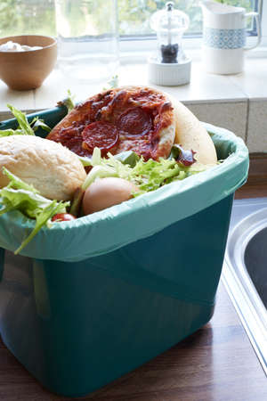 discarded: Fresh Food Waste In Recycling Bin At Home