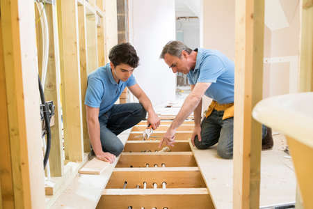 Plumber And Apprentice Fitting Central Heating