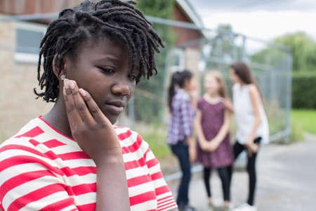 Sad Teenage Girl Feeling Left Out By Friends Standard-Bild