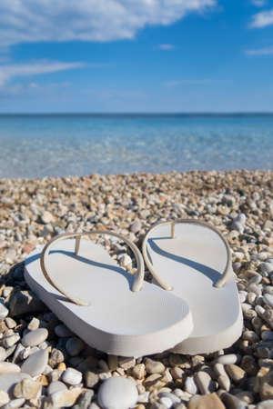 Close Up Of Sandals On Beautiful Greek Beach