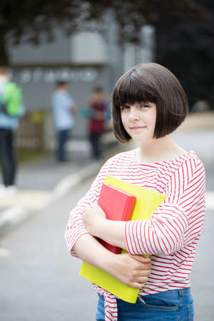 Portrait Of Female Teenage Student Outside School Building Stock Photo