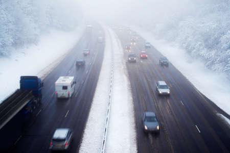 Traffic On Motorway During Snow Storm