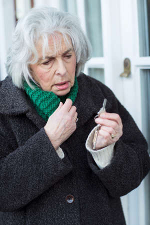 Confused Senior Woman Trying To Find Door Key