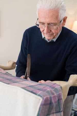 Senior Man Re-Upholstering Chair