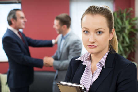 Portrait Of Unhappy Businesswoman With Male Colleague Being Congratulated Stock fotó
