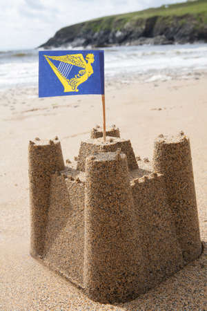 Sandcastle On Beach Flying Irish Flag Stock fotó