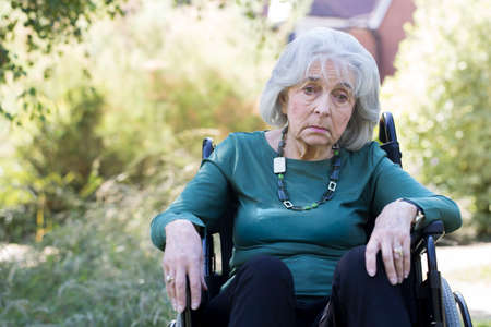 Depressed Senior Woman In Wheelchair Sitting Outdoors Imagens - 106500569